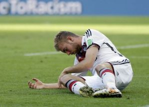 Germany's Christoph Kramer lies on the pitch after getting hit in the face by Argentina's Ezequiel Garay's shoulder during the World Cup final soccer match between Germany and Argentina at the Maracana Stadium in Rio de Janeiro, Brazil, Sunday, July 13, 2014. (AP Photo/Natacha Pisarenko) ORG XMIT: WCDP124 (Natacha Pisarenko)