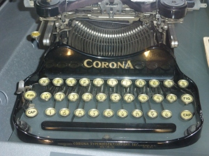 A Corona typewriter on display at the Danish  Jewish Museum in Copenhagen, Denmark. I am old enough to have used a typewriter (albeit electric ones) all through college, Even though I now write on a computer, sometimes my progress feels as though I'm back in the days of typewriters.